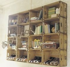 perhaps a row of wooden crates above the entry bench to hold shoes and slipper socks.  On top of the crates, a long shelf with decor.