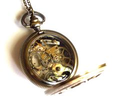 "Steampunk Necklace ""The Wheels of Time"" Pocket Watch Necklace by TimeMachineJewelry on Etsy https://www.etsy.com/uk/listing/233191483/steampunk-necklace-the-wheels-of-time"