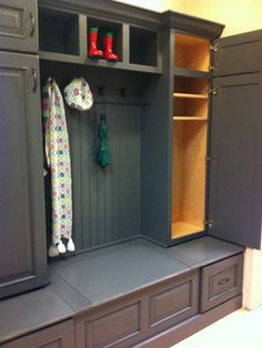 Gray Mudroom Boot Bench designed by Carole Kitchen and Bath Design featuring Dura Supreme Cabinetry shown gray painted cabinetry finish.