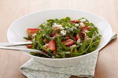 A medley of spinach and arugula salad greens are tossed with fresh berries, candied nuts, goat cheese, and our fig balsamic dressing.  This Strawberry