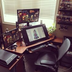 "I finally cleaned my office so I thought I'd snap a photo to share before it gets messy again. For anyone interested my work space consists of a Cintiq 24HD, 22"" Led View Sonic Monitor to my left. 27"" Led Benq Monitor above. My desk is 15 years old..."