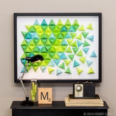We folded lots of paper triangles to create this 3D piece of art (framed with a display case.)
