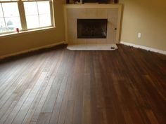 """Concrete """"wood"""" floor.  You can get whatever type of """"plank"""" and distressing you want.  What's not to love?"""