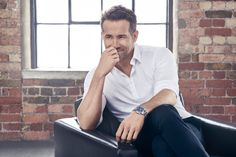 Ryan Reynolds in a clean and crisp white button down. Love the sleeves rolled up and the classic wristwatch. Ryan Reynolds, Stylish Watches, Luxury Watches For Men, Polo, Canadian Men, Lifestyle Articles, Well Dressed Men, Cute Guys, Celebrities
