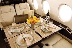 Table onboard a private jet which is set by a Corporate Flight Attendant.  Corporate Flight Attendant Recruitment at www.trainingsolutions.ch