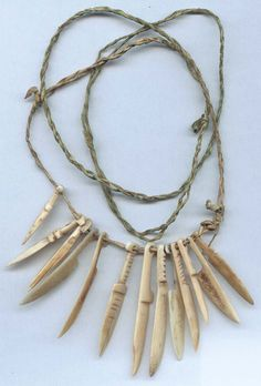 Inuit walrus ivory and bone dagger / knife effigy fetish necklace, strung on seal skin. Mid to late 1800s. Formerly in the collection of Stephen Parfitt, Springfield, Illinois.