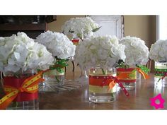 Centro de mesa para boda con moño de colores