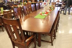 A long and spacious solid wood dining table perfect for any large family or family gathering! #shopGF | Houston TX | Gallery Furniture |