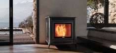 """A pellet stylisch fireplace from Nordic Fire. Nordic Fire named this model """"stylo"""". Pellet Fireplace, Decoration, Interior Inspiration, New Homes, Home Appliances, Wood, House, Home Decor, Van"""