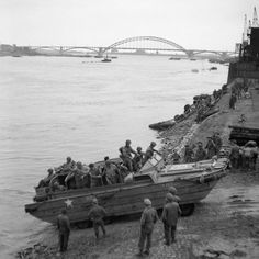 A British DUKW carries supplies and American paratroopers across the Waal river at Nijmegen, 30 September 1944., Midgley (Sgt) Market Garden