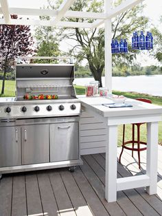 Grilling Station/ When space allows, add a countertop or island next to the grill to make food prep & service easier. A peninsula works well in this outdoor kitchen. It provides additional seating for outdoor dining that's close enough for the cook to chat with guests, but it keeps people away from a hot grill.