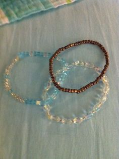 Set of 3 Beaded Stretch Bracelets. Clear, Bronze and Light Blue