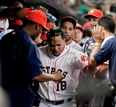 Astros taking off -        Luis Valbuena of the Houston Astros receives a sunflower seed shower after hitting a home run in the first inning against the Toronto Blue Jays on May 17 in Houston. The Astros won 4-2 for their fifth straight win. - © Bob Levey/Getty Images