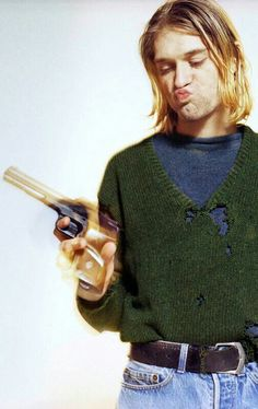 WHO THE FUCK GAVE HIM A FUCKING GUN?! I KNOW IT'S JUST FOR THE FUCKING PHOTOSHOOT BUT WHAT THE FUCK PEOPLE ARE SO STUPID!!!-sorry for the 'fuck's I'm just a bit upset...
