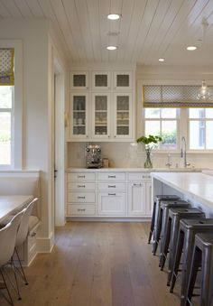 Light wood floors, metal stools and lap siding on the ceiling warm up this all-white kitchen by Modern Organic Interiors. Really like the top cabinets, Modern Farmhouse Kitchens, Modern Farmhouse Style, Farmhouse Kitchen Decor, Home Kitchens, Kitchen Modern, Farmhouse Small, Farmhouse Interior, Warm Kitchen, Long Kitchen
