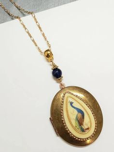 Peacock locket necklace – TOODLEBUNNY