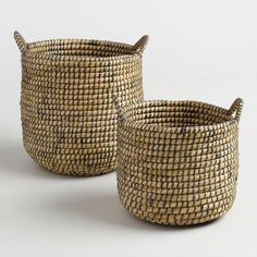 Natural seagrass is interwoven with espresso-hued recycled plastic to create our structured round tote baskets. Handcrafted in Bangladesh and fitted with sturdy handles, these open-topped beauties are available in small and large sizes.