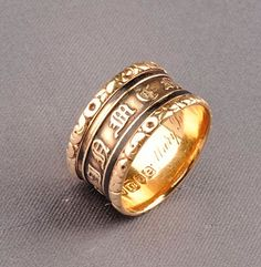 """Antique 18kt Gold and Enamel Memorial Band, England, with Gothic letters, black enamel bands and high relief foliate edges, size 8, London hallmarks and letter date for 1820, interior enrgraved """"Mary Brown ... Aged 26 Years""""."""