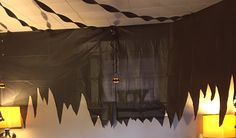 Our sons 3rd Birthday - Batman  The Batcave. This was made with black plastic table cloth and cut in a jagged pattern.  We finished the room off with black streamers and some black bats made from poster board hung from the ceiling. #batman #birthday #party #partyidea #batcave