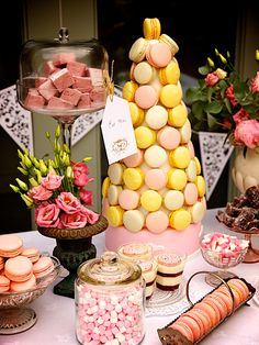 pink dessert and sweet buffet with a central Macaron Croquembouche