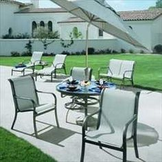 """Cascade Dining Groups - 74"""" Oval Dining Table with 6 Dining Chairs - Aluminum Patio Furniture by Woodard. $1899.00. Visit our site for Sling Color and Aluminum Finish options. Aluminum Dining Groups - 74"""" Oval Dining Table with 6 Dining Chairs. Crisp and clean, the Cascade collection offers that sleek architectural profile required in today's contemporary looks. Select from an array of eight exciting finishes and 10 of the most durable weather resistant sling fabri..."""