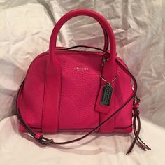 Coach Mini Preston Hot pink color! opens really wide. only one small spot on the bottom. Comes with a Crossbody strap. Outside phone pocket is very convenient! Coach Bags Mini Bags