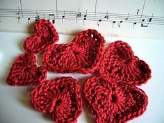 Crocheted Hearts if I get a chunky enough yarn I wonder could I make a scarf out of them