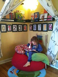 Love this idea - create a place for peace. A retreat to think, rest, read or just decompress. Hung curtain which can be closed. round tube out of garden material (or pool noodle), hooks on wall. shelves for some books. framed numbers. area rug and some pillows.