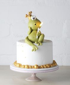 Mr Froggy - litte birthday cake with Mr Froggy blowing the candle