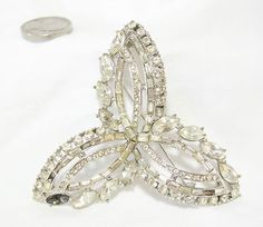 VINTAGE CLEAR RHINESTONE BROOCH CELTIC STYLE FLOWER FIX WEAR REPAIR 5 STONE MISS                            Seller information  justinsublime (1242  )      100% Positive feedback  Save this seller  See other items     AdChoice  Item condition:--  Time left: 9h 39m 50s (Nov 17, 2012 01:00:20 PST)  Current bid:US $0.99  [ 1 bid ]