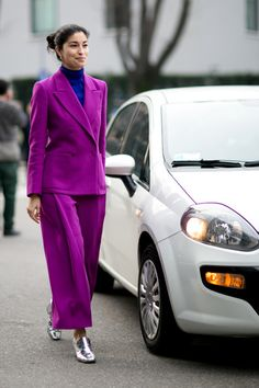 Somehow an oversized bright purple suit with metallic flats makes SO much sense
