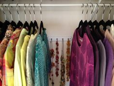 Hang jewelery on hooks BEHIND clothes in the closet - a great way to utilize space you never knew you had.