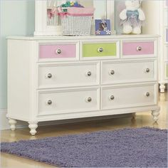 Pulaski Build-A-Bear Pawsitively Yours Kids Double Dresser in Vanilla - Finished in stunning vanilla, the Pawsitively Yours Double Dresser will create a look of unmatched beauty in your kid's bedroom. It features seven drawers for ample storage, each with dovetail construction for durability, metal guides for smooth operation and dust proof bottoms to protect your kid's clothing. With transitional design elements, the Pawsitively Yours Double Dresser offers a lasting appeal your child will enjoy for many years.