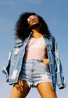 Be a girl boss in this beaut blue denim jacket! With a chic pink Barbie logo on the back, oversized fit and distressed patches, snap it up before we beat you to it!