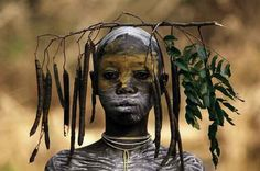 German photographer Hans Silvester photographs the dazzling artistry of the Surma and Mursi people of the Omo Valley in southern Ethiopia as they perform their ancient tradition of temporary body decoration on themselves and each other a few times each day.