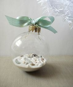 "collect sand while on vacation at the beach during the summer and put into a ""scrapbook"" ornament for the holidays!"