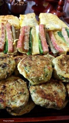 설날 음식, New Year's Korean food Korean enjoy lots of 전[jeon], pancake for traditional holiday such as New Year's Day or Chuseok. I helped cooking this a little bit and ate many pieces from time to time. Lol. The first line is 동그랑땡[donggurangttaeng], round shape of pancake, second line is 화양적[whayangjeok], multi color pancake and the last line is 생선전[sawngseonjeon], fish pancake.  Yummy taste of Jeon~ let's enjoy these together :)  명절이 되면 다양한 전을 붙여 먹습니다. 나도 전붙이는것을 조금 거들어 주었습니다. 냄새가 좋아서 중간중간 하나씩…