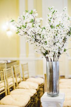 Michaels.com Wedding Department: Champagne Wedding Ceremony Floral Arrangements Use a simple flower, in a tall cylinder vase for your arrangements. When using more than one, place them on either side of your wedding aisle for the perfect setting.