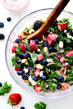 Triple Berry Kale Salad with Creamy Strawberry Poppyseed Dressing is made with delicious fresh summer berries and is tossed with ...