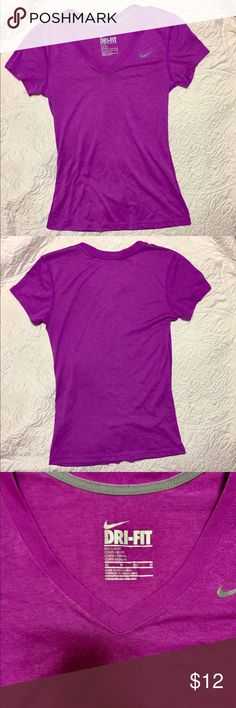 NIKE Dri Fit Athletic T-Shirt Top SZ XS Like new condition!!! Size Extra Small XS. V-neck. Regular Fit. Short sleeve. Fuchsia purple color. Great for workouts at the gym or everyday wear. Check out my other Activewear! Under Armour, Fabletics, Reebok, Lululemon and more. Nike Tops Tees - Short Sleeve