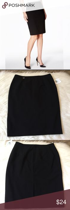 Calvin Klein skirt NWT Black classic skirt.  Has a back zipper and back slit.  Under lining, it measures 23 inches in length.  New with tags. Calvin Klein Skirts Pencil
