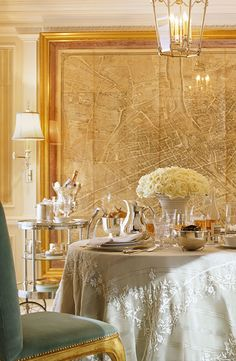 Glamorous dining room by Ralph Lauren Home.