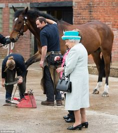 Queen Elizabeth is shown horses as she visits Myerscough College 29 May 2015