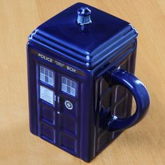 GeekAlerts has shown you the Doctor Who Disappearing Mug, but now here is the TARDIS Mug. The Doctor's time-traveling ride is here to serve your coffee and Doctor Who Mug, Doctor Who Tardis, Good Birthday Presents, Police Box, Jar Lids, Tea Mugs, Coffee Cups, Drink Coffee, Geek Stuff