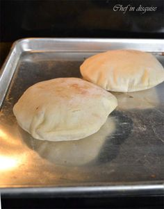 pita pockets puffing in the oven