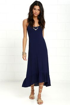 The dancing girl emoji wishes she could add the Wild Waves Navy Blue Lace-Up Midi Dress to her closet! Triangle bodice is supported by adjustable spaghetti straps, while a trendy lace-up back ends in cinching elastic. Woven rayon fabric falls to a ruffled hem with a slight high-low silhouette.