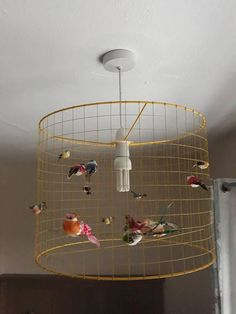 Large gold birdcage lampshade light lamp lamps pinterest a beautiful yellow coloured wire lampshade with a number of colourful artificial birds looks greentooth Gallery