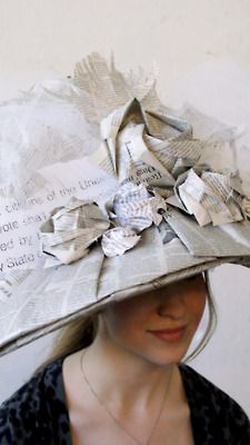 """The Modern Woman Wears Knowledge"" is a wearable sculpture made out of newspaper pages and book pages that replicates the style of Victorian era women's hats to reference the Women's Suffrage Movement and the changing societal standards."