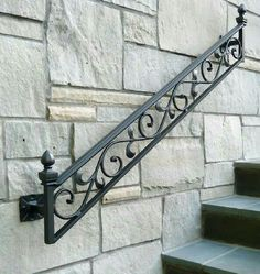 MICRO TREND // 12 Wrought Iron Products That Add Old-World Style To Your Home. Wall Mount Railing: This hand rail is a definite statement piece against a stone wall and stairs. Wrought Iron Stair Railing, Wrought Iron Decor, Wrought Iron Gates, Wrought Iron Designs, Wall Railing, Railing Design, Gate Design, Railing Ideas, Iron Furniture