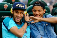 Neymar (L) jokes with Jonathan dos Santos of FC Barcelona prior to the La Liga match between Elche FC and FC Barcelona at Estadio Manuel Martinez Valero on May 11, 2014 in Elche, Spain.
